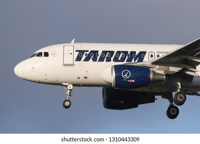TAROM Airbus A318 seen landing at London Heathrow LHR / EGLL international airport in blue sky. The registration is YR-ASC. TAROM is the flag carrier of Romania. London, UK / November 30, 2018