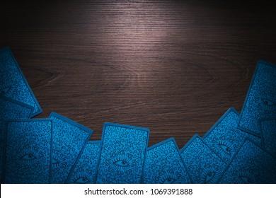Tarot card facing down on a table.