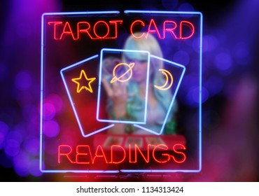 Tarot Card Readings Neon Sign in Window with Psychic Tarot Card Reader blurred in background