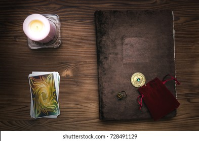Tarot cards. Book of magic on the table.