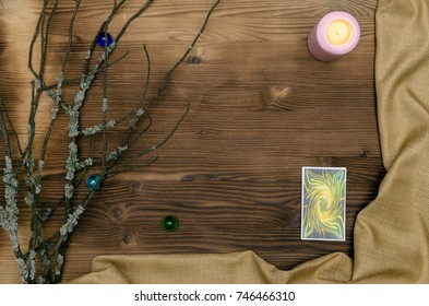 Tarot cards deck on wooden table with copy space. Fortune teller table.