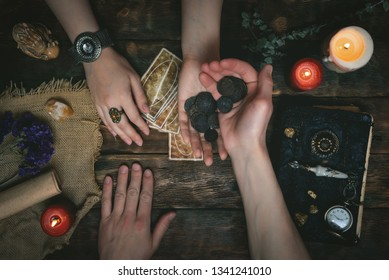 Tarot cards, magic book, fortune teller hands and thanks for fortune telling concept.