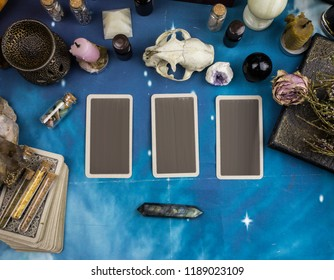 tarot cards and natural stones on a blue background, cat skull, witchcraft, wicca, holiday of halloween