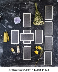 tarot cards, natural stones, witchcraft, dry grass on a black background