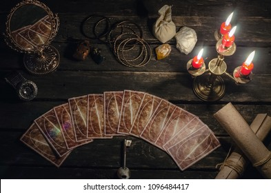 Tarot cards on fortune teller desk table background. Fortune reading concept. Magic mirror and key to the fate.