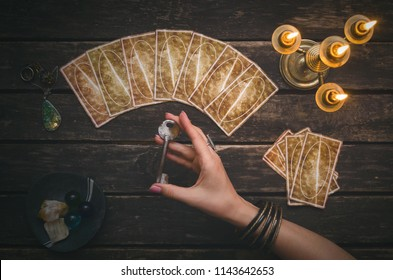 Tarot cards on fortune teller desk table background. Magic key to secrets of fate. Futune reading concept. Divination.