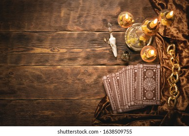 Tarot cards on fortune teller old desk background. Future reading.