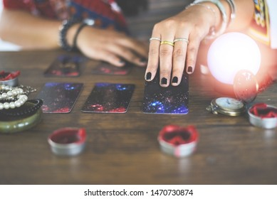 Tarot cards reading divination Psychic readings and clairvoyance concept / Crystal ball fortune teller hands
