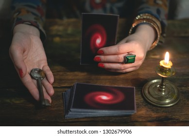 Tarot cards and a woman fortune teller with a unravelling key of fate. Future reading concept. Divination.