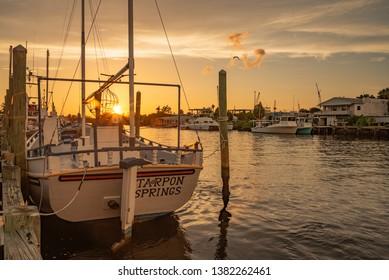 Tarpon Springs, FL 7/28/2018 Sunset over boat docked at sponge exchange on Anclote River