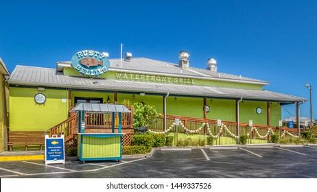 TARPON SPRINGS, FLORIDA - JUNE 30, 2019: Tarpon Springs, Florida. Rusty Bellies bright green waterfront grill seafood restaurant.