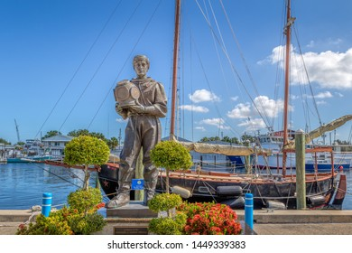 TARPON SPRINGS, FLORIDA - JUNE 30, 2019: Tarpon Springs, Florida. A small historical waterside town with a sponge dock for boats and statue of a diver.