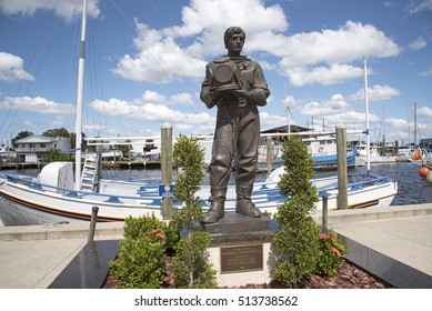 Tarpon Springs Florida USA - October 2016 - A sculpture in memory of the 'spongers' on the waterfront at Tarpon Springs