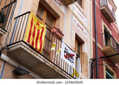 Tarragona, Tarragona / Spain - 05-18-2018: Catalan flag hanging at the balcony of an apartment to show they support the Catalan independence movement.