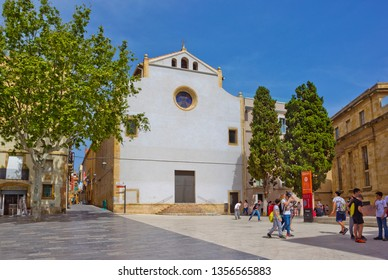 Tarragona, Spain - April 25, 2018:  Square with old buildings and many people in the historical quarter of the town