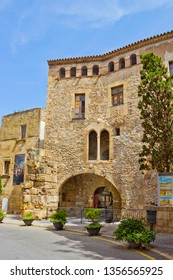 Tarragona, Spain - April 25, 2018:  Gothic building with remains of roman wall in Placa Pallol