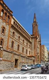Tarragona, Spain - April 25, 2018:  Carrer de l'Assalt with church Padres Carmelitas Descalzos De Cataluna & Baleares