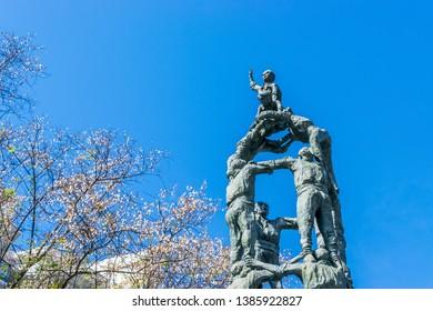 TARRAGONA, SPAIN - APRIL 4, 2019: Castellers monument  on the Rambla Nova