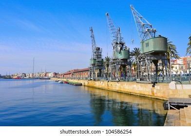 TARRAGONA, SPAIN - FEBRUARY 10: Old cranes in the port on February 10, 2012 in Tarragona, Spain. Part of the old port facilities have been converted into museums and art galleries