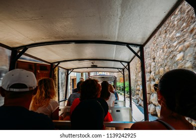 Tarragona, Spain - July 11 2018: Wide angle view from inside a tourist excursion train in the historic centre of Tarragona, Catalonia, Spain