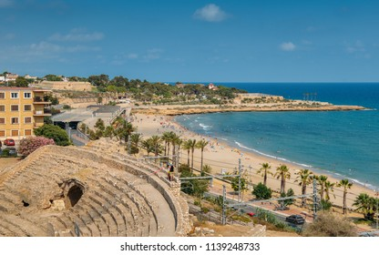 Tarragona, Spain - July 11, 2018: Panoramic view of the ancient roman amphitheater of Tarragona, Spain, next to the Mediterranean sea - UNESCO World Heritage Site Ref 875