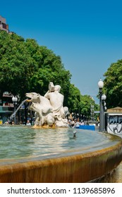 Tarragona, Spain - July 12, 2018: Fountain of the Centenary decorated with sculptures depicting four continents on Rambla Nova in the commercial centre of Tarragona