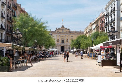 TARRAGONA, SPAIN - JULY 28, 2018: A view of Placa de la Font square in the Part Alta, the Old Town of Tarragona, Spain, with the City Hall in the background