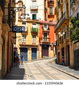 TARRAGONA, SPAIN - JULY 28, 2018: The Baixada de la Misericordia street in the Part Alta, the Old Town of Tarragona, Spain, with its colorful buildings and its characteristic cobblestone pavement