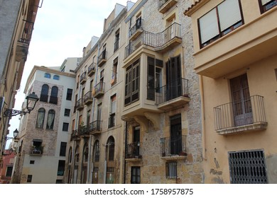 Tarragona / Spain - June 11 2020: Authentic street view with residential houses, captured in Tarragona city