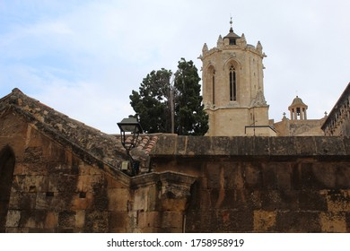 Tarragona / Spain - June 11 2020: Worm's eye view on the old church tower of the cathedral in Tarragona city