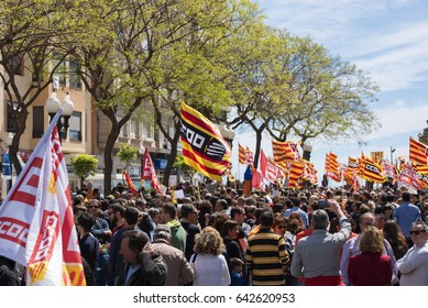 TARRAGONA, SPAIN - MAY  01, 2017: People at the street of Tarragona at the demonstration of 1st of may.