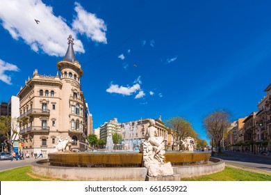 TARRAGONA, SPAIN - MAY 1, 2017: Fountain decorated with sculptures depicting four continents. The Century's Fountain. Chamber of Commerce of Tarragona. Copy space. Space for text