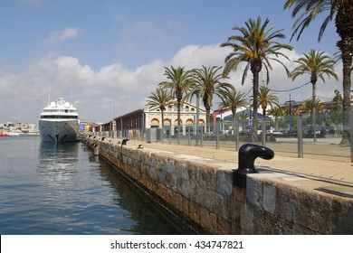 TARRAGONA, SPAIN - MAY 21, 2016: City view of Tarragona recreative harbor, with a luxury yacht moored on it, on May 21, 2016 in the city of Tarragona, Spain