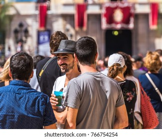 TARRAGONA, SPAIN - SEPTEMBER 17, 2017: Holiday of Santa Tecla, a crowd of people in the square. Close-up