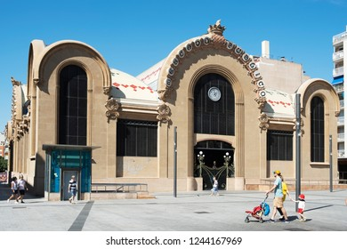 TARRAGONA, SPAIN - SEPTEMBER 23, 2018: A view of the main facade of the historical Central Public Market of Tarragona, and the Corsini Square, in Tarragona, Spain