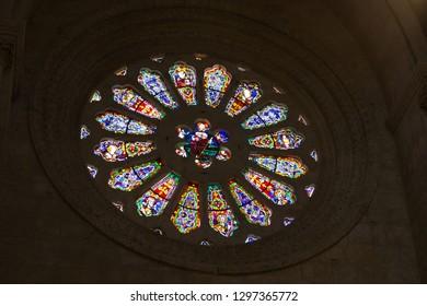 Tarragona , Spain - September, 6, 2018. Interior of Tarragona cathedral. Round window (rosette). This church is the main medieval landmark of Tarragona.