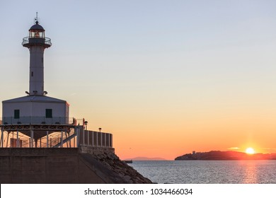 TARRAGONA,SPAIN- DECEMBER 23,2017: Ancient lighthouse, Far de la Banya in port of  Tarragona,Spain.