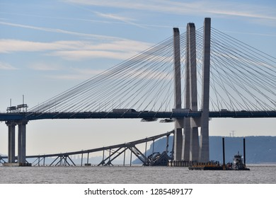 TARRYTOWN, NY JANUARY 15, 2019: The Old Tappan Zee Bridge East Tower is seen resting in the Hudson River with the New York skyline along side the new Eastern Towers of the Mario Cuomo Bridge.