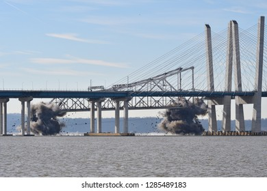 TARRYTOWN, NY - JANUARY 15, 2019: The Old Tappan Zee Bridge East Tower is demolished by controlled explosives and seen here in mid air falling into the Hudson River.