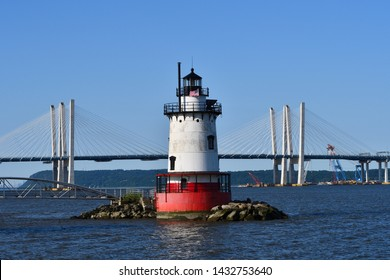 TARRYTOWN, NY JUNE 23, 2019: The New Tappan Zee Bridge (The Governor M. Cuomo Bridge) spans the Hudson River with the Tarrytown Light House in the foreground.