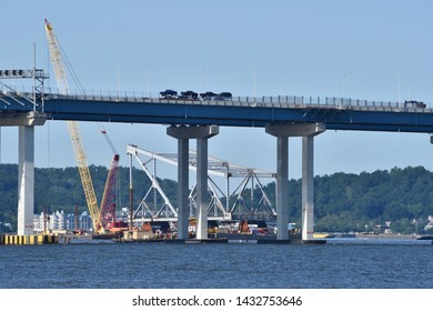 TARRYTOWN, NY JUNE 23, 2019: A section of the old Tappan Zee Bridge is seen installed on barges in the Hudson River in preparation for recycling.