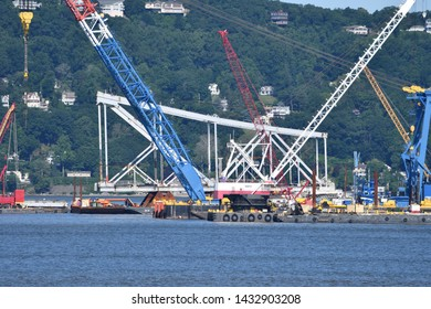 TARRYTOWN, NY JUNE 23, 2019: Parts of The Old Tappan Zee Western Tower sit on barges in the Hudson River in preparation for recycling.