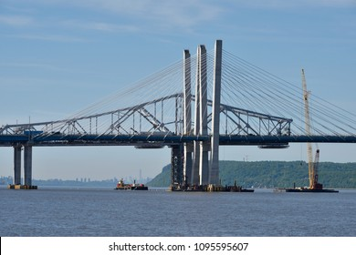 TARRYTOWN, NY - MAY 21, 2018: The new Tappan Zee bridge is under construction and the old span is being disassembled into pieces. A closeup of the Eastern towers on a sunny day.