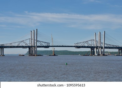 TARRYTOWN, NY - MAY 21, 2018: The new Tappan Zee bridge is under construction and the old span is being disassembled into pieces. A view of the Eastern and Western towers on a sunny day.