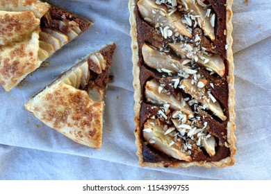 Tart and galette with pear and almond filling. Top view.