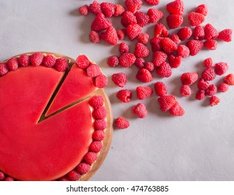 Tart with jellied and fresh raspberry on the light concrete background. Slice of cake