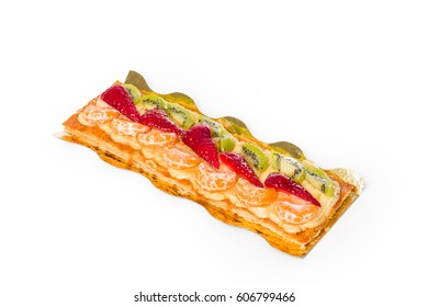 Tart of kiwi, strawberries and mandarin with puff pastry on white background