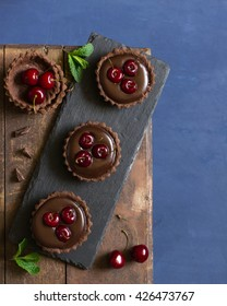 Tart lets with chocolate cream and cherry