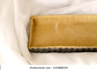 Tart pastry in a tray. Selective focus.