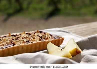 Tart with pear and almond filling and decoration. Selective focus.